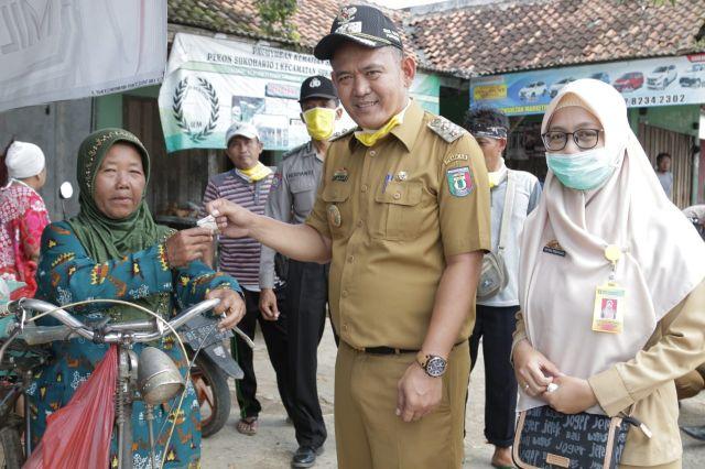Wabup Pringsewu, DPRD, Polisi Sosialisasi DBD & Covid-19 & Bagikan Masker